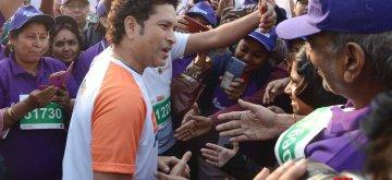Kolkata: Former Indian cricketer Sachin Tendulkar interacts with the participants during the flagging off ceremony of IDBI Federal Life Insurance Kolkata Full Marathon, on Feb 3, 2019. (Photo: Kuntal Chakrabarty/IANS)