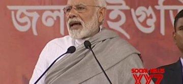 Mainaguri: Prime Minister Narendra Modi addresses during a public meeting in Mainaguri, West Bengal on Feb 8, 2019. (Photo: IANS/BJP)