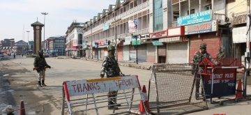 Srinagar: Security personnel man a Srinagar street during a separatist-called shutdown in the Kashmir Valley to mark the 35th death anniversary of Jammu and Kashmir Liberation Front (JKLF) founder, Maqbool Bhat on Feb 11, 2019. (Photo: IANS)