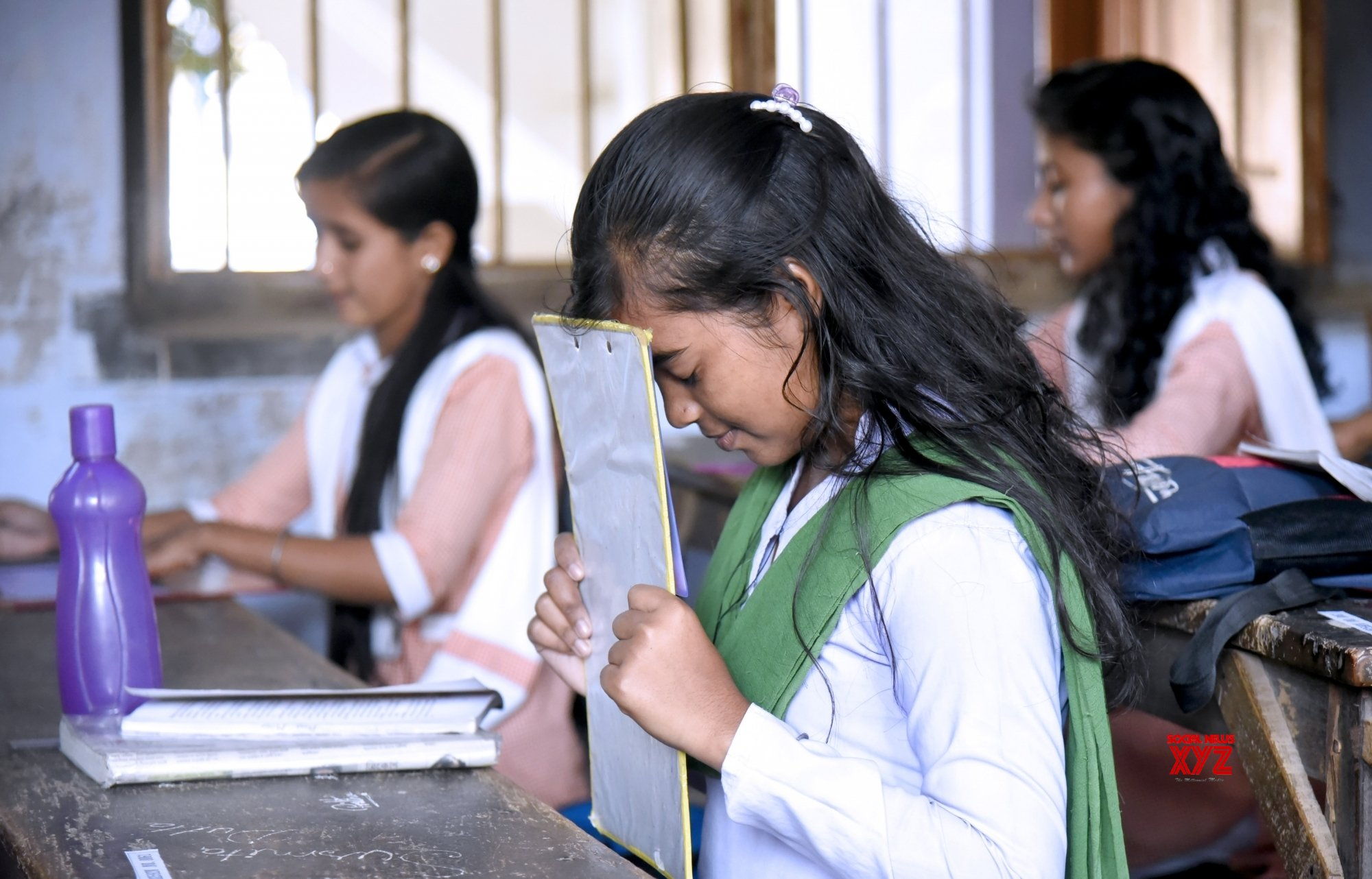 Bolpur: Class 10 exams - Student prays in exam hall #Gallery