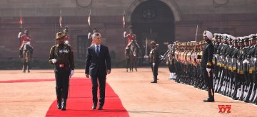 New Delhi: Argentina President Mauricio Macri inspects the Guard of Honour during a ceremonial reception organised for him at Rashtrapati Bhawan in New Delhi, on Feb 18, 2019. (Photo: IANS/MEA)