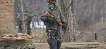 Kupwara: A soldier at the site of an encounter with militants in Jammu and Kashmir's Kupwara district on March 1, 2019. Two militants were killed in the gunfight. (Photo: IANS)