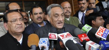 Uttarakhand Chief Minister Vijay Bahuguna addresses press after submitting his resignation to Uttarakhand Governor Aziz Qureshi in Dehradun on Jan.31, 2014. (Photo: IANS)