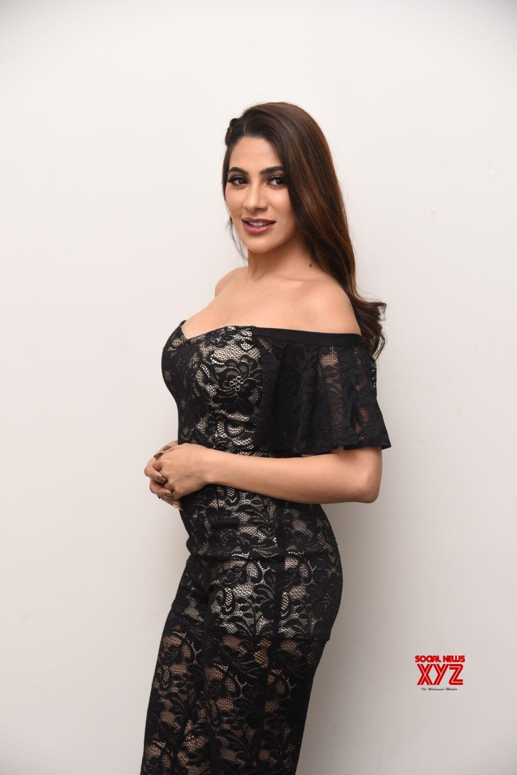 Actress Nikki Tamboli Hot Stills From Chikati Gadhilo Chithakotudu Movie Pre Release Event