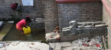 (190322) -- KATHMANDU, March 22, 2019 (Xinhua) -- A kid fills water from the traditional stone tap in Lalitpur, Nepal, March 22, 2019, the World Water Day. People of Kathmandu valley still face the problem of scarcity of drinking water. (Xinhua/Sunil Sharma)