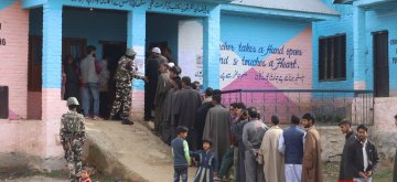 Kupwara: People wait in a queue to cast their votes for the first phase of 2019 Lok Sabha elections, at a polling booth in Jammu and Kashmir's Kupwara district, on April 11, 2019. (Photo: IANS)