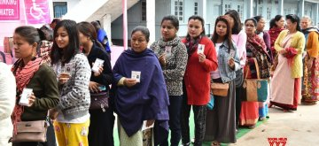 Shillong: Voters wait in a queue to cast their votes during Meghalaya Assembly elections in Shillong on Feb 27, 2018. A total of 18,09,818 electorates, including 9,13,702 women and 89,405 first-time voters are eligible to exercise their franchise to decide the fate of 361 candidates, including 31 women and many independents. (Photo: IANS/PIB)