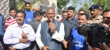 Uttarakhand Chief Minister Trivendra Singh Rawat showing his inked finger after casting his vote for Lok Sabha election in Dehradun on April 11, 2019. (Photo: IANS)