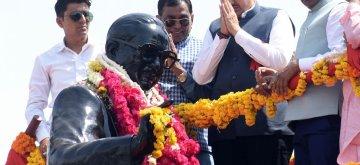 Ahmedabad: Maharashtra Chief Minister Devendra Fadnavis pays homage to B.R. Ambedkar on his birth anniversary in Ahmedabad, on April 14, 2019. (Photo: IANS)