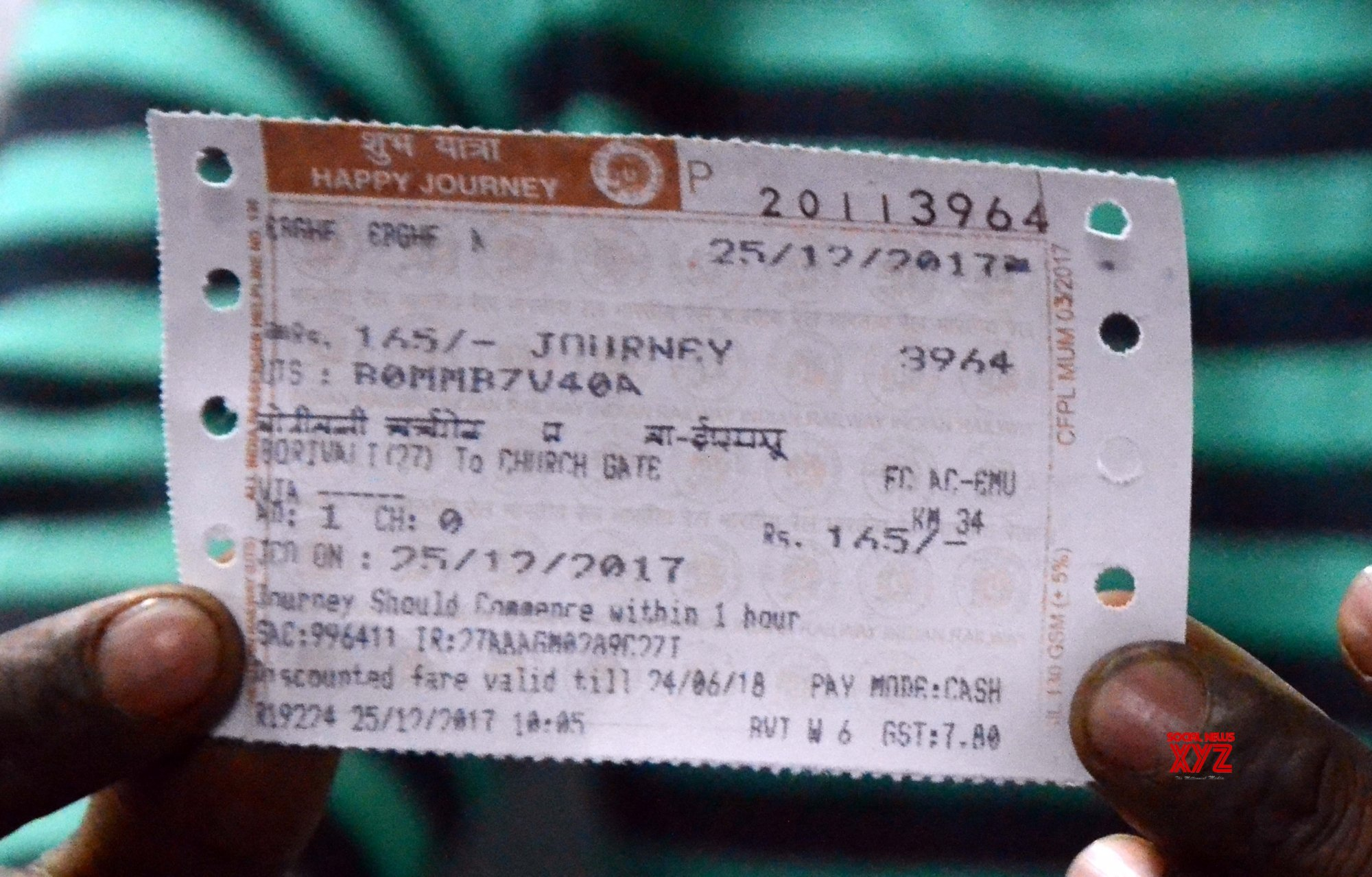 Railways suspends 4 for issuing tickets with Modi image