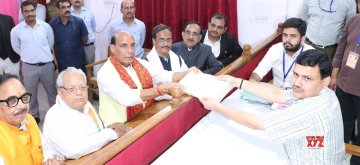 Lucknow: Union Minister and BJP's Lok Sabha candidate from Lucknow, Rajnath Singh accompanied by Uttar Pradesh Deputy Chief Minister Dinesh Sharma and BJP state President Mahendra Nath Pandey, files his nomination papers for the forthcoming Lok Sabha elections, in Lucknow on April 16, 2019. (Photo: IANS)
