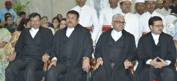 Patna: The four lawyers - Anjani Kumar Sharan, Anil Kumar Sinha, Prabhat Kumar Singh and Partha Sarthy, who were sworn in as the Judges of Patna High Court by Patna High Court Chief Justice Amreshwar Pratap Sahi, on April 17, 2019. (Photo: IANS)
