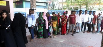 Chennai: People wait in a queue to cast their vote for the second phase of 2019 Lok Sabha elections, at a polling station in Chennai on April 18, 2019. (Photo: IANS)