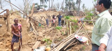 Mirzapur: An official of the nine-member central team takes stock of the damage caused by Cyclone Fani during his visit to the cyclone affected areas of Mirzapur village in Rasulpur Tehsil of Odisha's Jajapur district on May 14, 2019. (Photo: IANS)