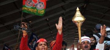 Varanasi: A Samajwadi Party worker with a BSP worker during a joint rally of SP, BSP and RLD  in Varanasi, Uttar Pradesh on May 16, 2019. (Photo: IANS)