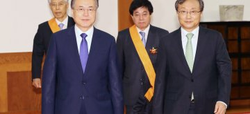 Seoul: President Moon Jae-in (L, front) and Constitutional Court chief Yoo Nam-seok (R, front) walk with Cho Yong-ho (L, rear) and Suh Ki-suhk, the court's retired justices, at the presidential office Cheong Wa Dae in Seoul on May 17, 2019, after a ceremony to confer state medals on the two former justices, who retired last month after serving out their six-year terms.(Yonhap/IANS)