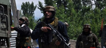 Pulwama: A security personnel during cordon and search operation after two militants were killed in a gunfight with the security forces, at Panzgam in Jammu and Kashmir's Pulwama district, on May 18, 2019. One of the slain militants has been identified as Showkat Ahmad Dar, a resident of Panzgam village. He belonged to the Hizbul Mujahideen (HM) outfit. (Photo: IANS)
