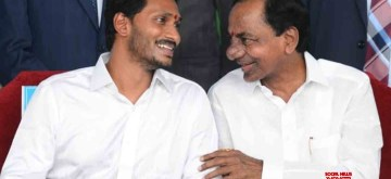 Vijayawada: Telangana Chief Minister K. Chandrashekhar Rao in a conversation with YSR Congress Party (YSRCP) President Y. S. Jagan Mohan Reddy at the latter's swearing-in as the Chief Minister of Andhra Pradesh, at Indira Gandhi Municipal Stadium in Vijayawada on May 30, 2019. (Photo: IANS)