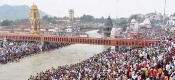 Haridwar: Devotees throng Har Ki Pauri to take a holy dip in the waters of Ganga river on the occasion of 'Somvati Amavasya' (also called Vat Savitri Puja) in Haridwar, Uttarakhand on June 3, 2019. (Photo: IANS)