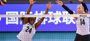 JIANGMEN, June 12, 2019 (Xinhua) -- Chiaka Ogbogu and Michelle Bartsch-Hackley (R) of the United States block the ball during the 2019 FIVB women's volleyball nations league between the United States and Poland, in Jiangmen, south China's Guangdong Province, June 12, 2019. (Xinhua/Deng Hua/IANS)