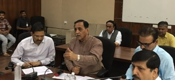 Gandhinagar: Gujarat Chief Minister Vijay Rupani chairs a review meeting with senior officials on preparedness of state administration in view of Cyclone Vayu which is likely to hit the Gujarat coast on Thursday, at the State Emergency Operation Center in Gandhinagar on June 12, 2019. (Photo: IANS)