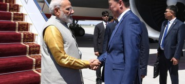 Bishkek: Bishkek: Kyrgyzstan Prime Minister Mukhammedkalyi Abylgaziev welcomes Prime Minister Narendra Modi on his arrival in Bishkek, Kyrgyzstan to attend the meeting of the Shanghai Cooperation Organization (SCO) Summit 2019, on June 13, 2019. (Photo: IANS/MEA)