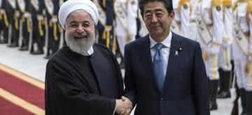 TEHRAN, June 12, 2019 (Xinhua) -- Japanese Prime Minister Shinzo Abe (R, front) shakes hands with Iranian President Hassan Rouhani during a welcome ceremony in Tehran, Iran, June 12, 2019. Iranian President Hassan Rouhani on Wednesday said that the Islamic republic welcomes Japan's efforts for the development of mutual ties as well as regional and international cooperation. (Xinhua/Ahmad Halabisaz/IANS)