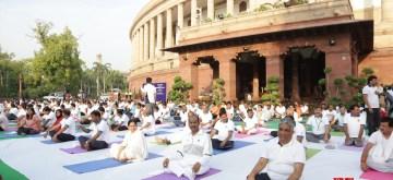New Delhi: Members of Parliament practice yoga at Parliament House on International Yoga Day, June 21, 2019. (Photo: Amlan Paliwal/IANS)