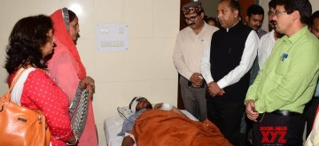 Kullu: Himachal Pradesh Chief Minister Jai Ram Thakur meets those who sustained injuries in a bus accident, at a hospital in Himachal Pradesh's Kullu on June 21, 2019. A total of 73 passengers were on board when an overloaded private mini bus skidded off the road and fell into a deep gorge near Banjar, some 50 km from Kullu town, on Thursday. The death toll in the accident increased to 44, on Friday. (Photo: IANS)