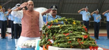 New Delhi: Union Defence Minister Rajnath Singh pays tributes to five of the 13 air-warriors, who lost their lives in the AN-32 crash in Arunachal Pradesh on June 3; at the Palam Technical area in New Delhi on June 21, 2019. (Photo: Twitter/@rajnathsingh)