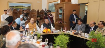 Srinagar: Union Home Minister Amit Shah chairs a meeting to review the security arrangements for the Amaranth Yatra, in Srinagar on June 26, 2019. Also seen  Jammu and Kashmir Governor Satya Pal Malik, Union Home Secretary Rajiv Gauba and other senior officials. (Photo: IANS/PIB)