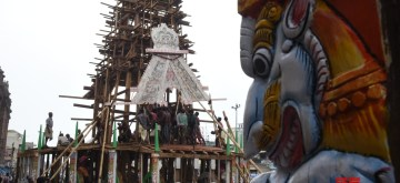 Puri: Workers busy building a chariot ahead of Rath Yatra or Chariot festival, in Odisha's Puri on July 1, 2019. (Photo: IANS)