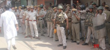 New Delhi: Security beefed up in Central Delhi's Hauz Qazi area where a minor scuffle over parking of a scooty took a communal turn following violent clashes that broke out late on Sunday night; on July 2, 2019. The situation in the area remained tense as minor clashes continued even on Monday afternoon. (Photo: IANS)