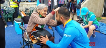 """Birmingham: India skipper Virat Kohli greets 87-year-old Charulata Patel, who became a social media sensation after an image of her blowing a horn to cheer the Men in Blue during their World Cup match against Bangladesh went viral, at the Edgbaston Cricket Ground on July 2, 2019. """"I have been watching cricket for last many decades. Earlier, I used to watch on TV when I was working, but now that I am retired I watch it live,"""" she said. (Photo: IANS)"""