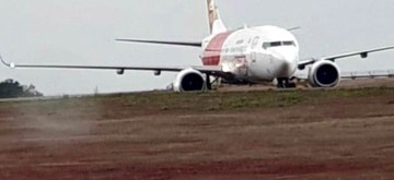 Mangaluru: An Air India Express aircraft VT-AYA, operating IX 384, Dubai to Mangalore veered off the taxiway after landing and got stuck into soft ground at the Mangaluru airport, on June 30, 2019. 183 passengers and crew members on board the Dubai-Mangalore flight are safe. (Photo: IANS)