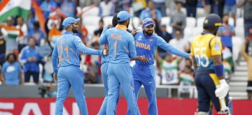 Leeds: Indian players celebrate the dismissal of Sri Lanka's Dimuth Karunaratne during the 44th match of World Cup 2019 between India and Sri Lanka at Headingley Stadium in Leeds, England on July 6, 2019. (Photo: Surjeet Yadav/IANS)