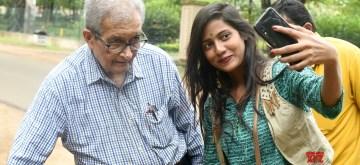 Birbhum: A woman seen taking selfie with Nobel laureate economist Amartya Sen in Birbhum, West Bengal, on July 7, 2019. (Photo: Indrajit Roy/IANS)
