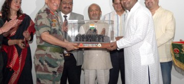 Gen Bipin Rawat Chief of the Army Staff and other army felicitating Lyricist Sameer Anjaan.