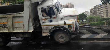 Mumbai: A dumper rammed in to the divider at Lalbaug, in Mumbai on July 8, 2019. (Photo: IANS)