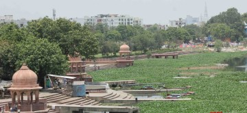 Lucknow: A view of the Gomti river covered with the carpet of water hyacinth, in Lucknow on June 26, 2019. A survey carried out by a team of environmentalists has found that the dissolved oxygen (DO) in the Gomti river has dipped to dangerous levels and can no longer sustain aquatic life. The DO level should be at least 8.5 mg/litre to make river water fit for human consumption while a drop below 5 mg /litre makes it unfit for flora and fauna. The DO level of Gomti river water has gone down to 0.5 mg/litre. (Photo: IANS)
