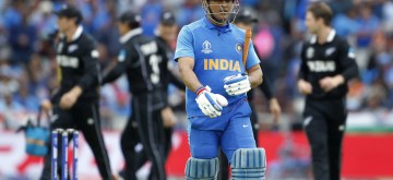Manchester: India's M.S. Dhoni walks back to the pavilion after getting dismissed during the 1st Semi-final match of 2019 World Cup between India and New Zealand at Old Trafford in Manchester, England on July 10, 2019. (Photo: Surjeet Kumar/IANS)