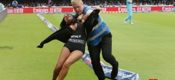 London: Security personnel tackle a pitch invader during the final match of the 2019 World Cup between New Zealand and England at the Lord's Cricket Stadium in London, England on July 14, 2019. (Photo: Surjeet Yadav/IANS)
