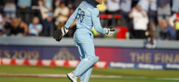 London: England's Jos Buttler dismisses James Neesham in the last ball of the super over to win the 2019 World Cup on July 15, 2019. (Photo: IANS)