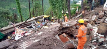 Kumarhatti: Rescue operations underway at the site where a roadside three-storey eatery caved in owing to heavy rains in Kumarhatti in Himachal Pradesh's Solan district on July 14, 2019. At least 10 people were pulled out from the debris while 20 were still trapped inside. (Photo: IANS)