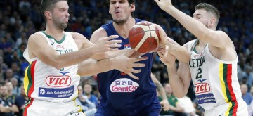 BELGRADE, Aug. 11, 2019 (Xinhua) -- Serbia's Boban Marjanovic (C) vies with Lithuania's Martinas Geben (R) and Mantas Kalnietis during a friendly basketball match between Serbia and Lithuania in Belgrade, Serbia on Aug. 10, 2019. (Xinhua/Predrag Milosavljevic/IANS)