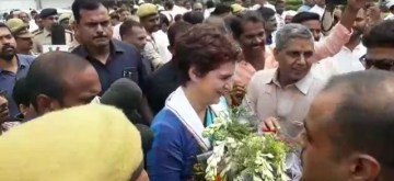 Varanasi: Congress General Secretary Priyanka Gandhi Vadra arrives at Lal Bahadur Shastri International Airport in Varanasi on Aug 13, 2019. Priyanka on Tuesday arrived at Varanasi to visit Ubbha village in Uttar Pradesh's Sonebhadra district, where 10 people died last month in a caste carnage. (Photo: IANS)