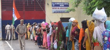 Mathura: Women queue up to celebrate Raksha Bandhan outisde Mathura District jail, on Aug 15, 2019. (Photo: IANS)