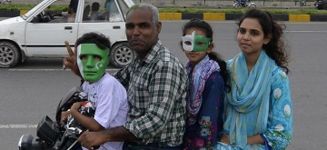 ISLAMABAD, Aug. 14, 2019 (Xinhua) -- Pakistani people wearing masks painted with national flag color are seen during the Independence Day celebrations in Islamabad, Pakistan, on Aug. 14, 2019. Pakistan got independence from the British colonial rule on Aug. 14, 1947. (Xinhua/Ahmad Kamal/IANS)