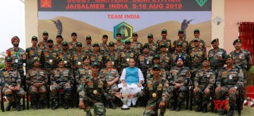Jaisalmer: Defence Minister Rajnath Singh with the Indian Army contingent at the 5th International Army Scout Masters Competition 2019 in Jaisalmer, Rajasthan on Aug 16, 2019. Also seen Army Chief General Bipin Rawat. (Photo: IANS/PIB)