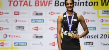 BASEL, Aug. 25, 2019 (Xinhua) -- India's Sindhu Pusarla V. poses on the podium during the awarding ceremnoy after the women's singles final match against Japan's Okuhara Nozomi at the BWF Badminton World Championships 2019 in Basel, Switzerland, Aug. 25, 2019. (Xinhua/Li Jundong/IANS)